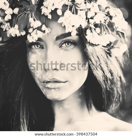 Black and white portrait of beautiful romantic lady in a wreath of apple trees  - stock photo
