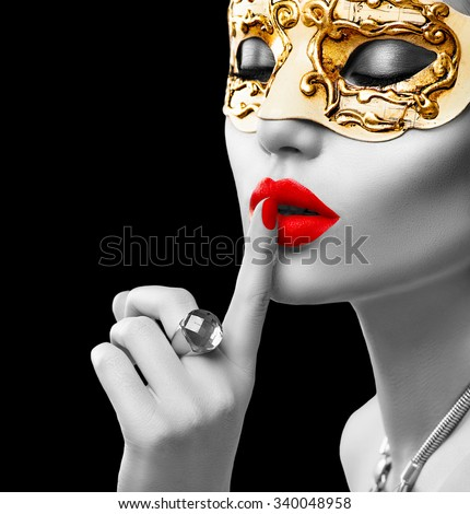 Black and white portrait of Beauty model woman wearing venetian masquerade carnival mask at party isolated on black background. Christmas and New Year celebration. Glamour lady with perfect make up - stock photo