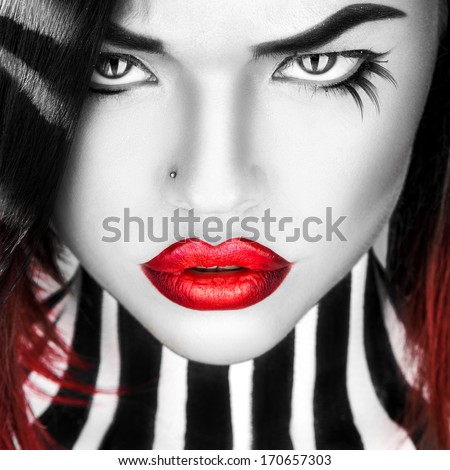Black and white portrait of beauty woman with red lips in studio