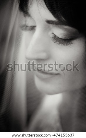 Black and white portrait of bride's beautiful calm face