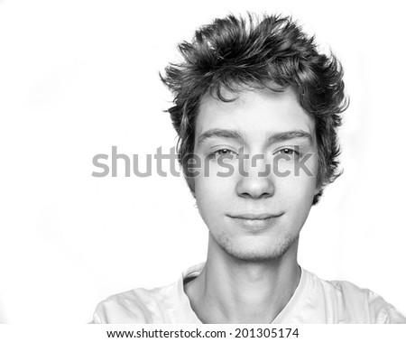 Black and white portrait of good smiling guy in t-shirt