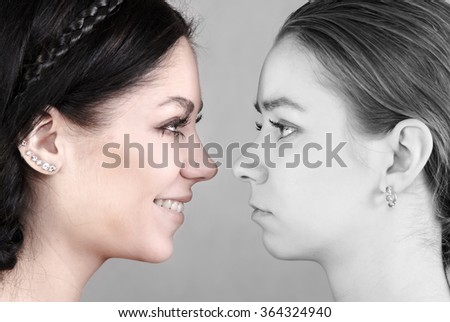 Black and white portrait of happy and sad women - stock photo