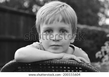 black and white portrait of little boy - stock photo