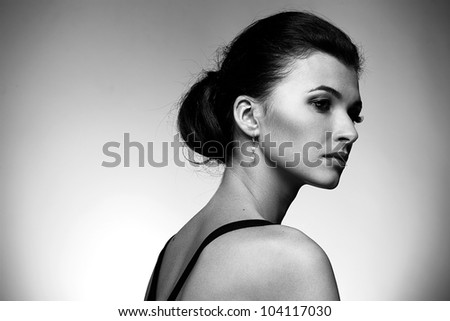 Black and white portrait of luxury woman in exclusive jewelry on natural background - stock photo