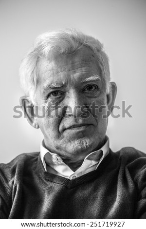 Black and white portrait of male pensioner