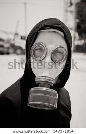 Black and white portrait of man wearing gasmask - stock photo