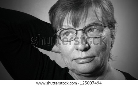 black and white portrait of middle aged woman in eyeglasses