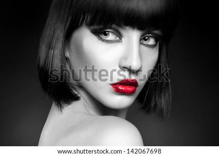 black and white portrait of pretty young brunette in studio - stock photo