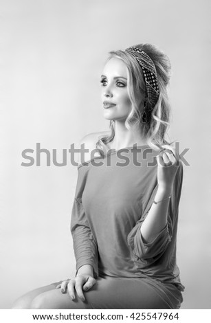 Black and white portrait of retro sixties blonde woman - stock photo
