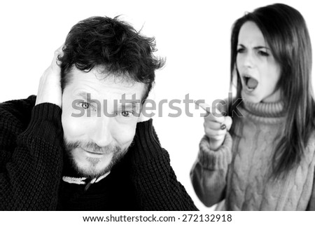 Black and white portrait of sad man with bad wife - stock photo