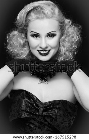 Black and white portrait of smiling happy vintage beauty with curly hair - stock photo