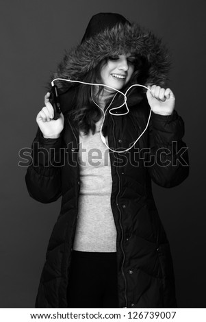 Black and White portrait of trendy teenage girl enjoying modern music