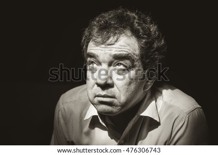 Black and white portrait of unhappy man