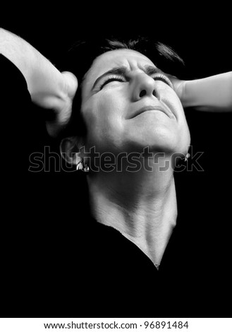 Black and white portrait of very stressed woman with a desperate or crazy expression