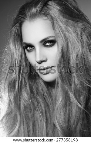 Black and white portrait of young beautiful stylish woman with long hair