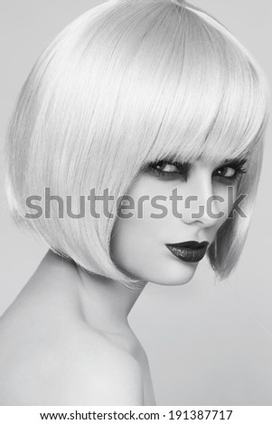 Black and white portrait of young beautiful woman with stylish bob haircut
