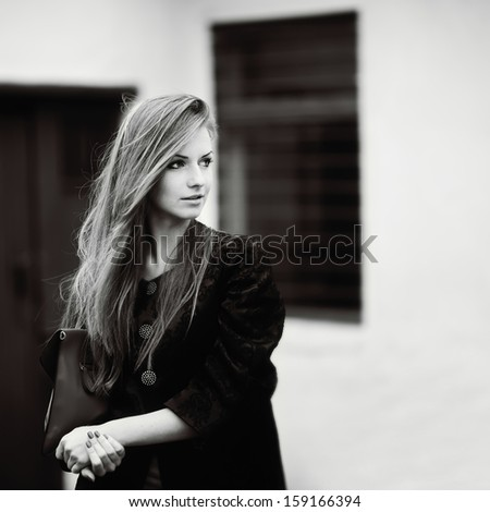 Black and white portrait of young cute woman.