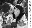 Black and white portrait of young romantic couple - stock photo