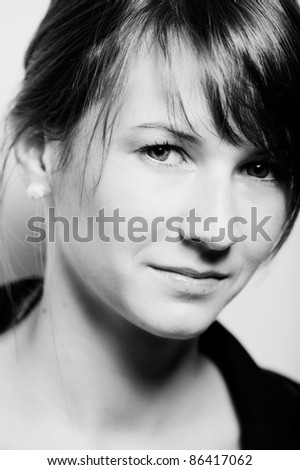 Black and white portrait of  young smiling woman - stock photo