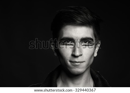 Black and white portrait photo young actor. Nice guy with professional makeup. Photo socio cultural magazines, posters and websites.