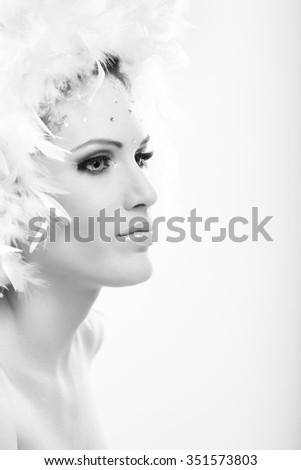 Black and white profile of attractive winter girl in glamorous makeup.