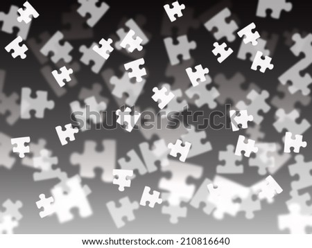 black and white puzzle pieces on a black gradient background - stock photo
