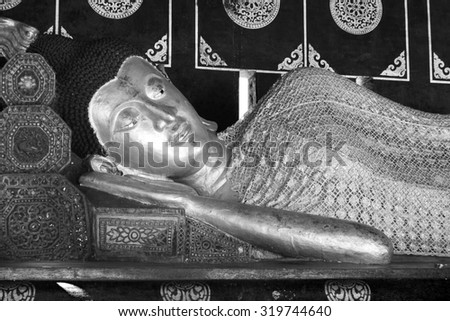 Black and White Reclining Buddha statue in Thailand - stock photo