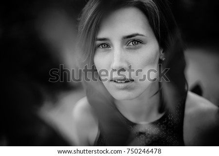 Black and white romantic photo of young and attractive woman with the beautiful cheekbones. Woman concept