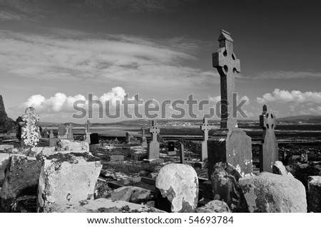 black and white rural celtic grave site - stock photo