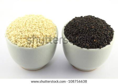 Black and white sesame in a bowl - stock photo