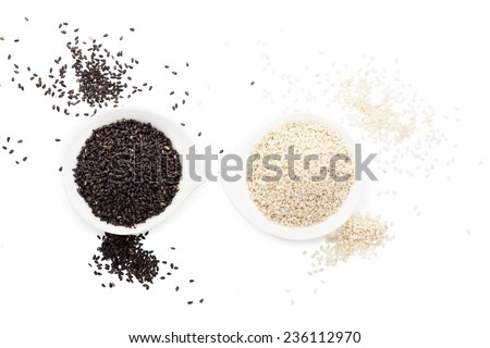 Black and white sesame seeds isolated on white background top view with clipping path.  - stock photo