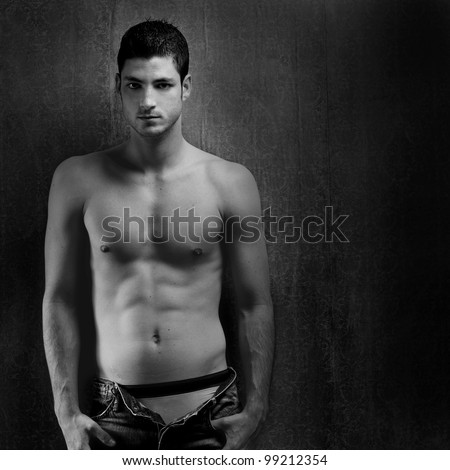 Black and white sexy young denim shirtless man on retro grunge background - stock photo