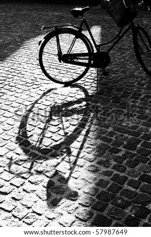 Black and white shadow of amsterdam bike - stock photo