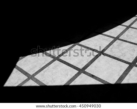 black and white shadow on floor