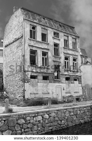 Black and white shot of a abandoned house in the old part of Wismar, Germany