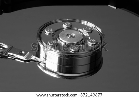Black and white shot of a hard drive in lateral view