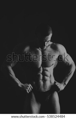 Black and white  shot of a male bodybuilder showing off his muscles