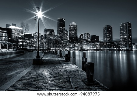Black and White shot of Boston Harbor and Financial district in Boston, Massachusetts.