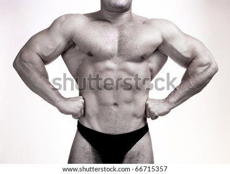 Black and white shot of muscular male torso