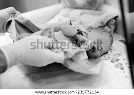 Black and white shot of newborn baby right after delivery  - stock photo
