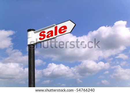 Black and white signpost with the word Sale against a blue cloudy sky