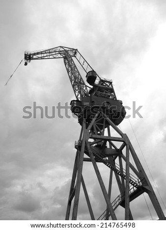 black and white  silhouettes of cranes in the shipyard.     - stock photo