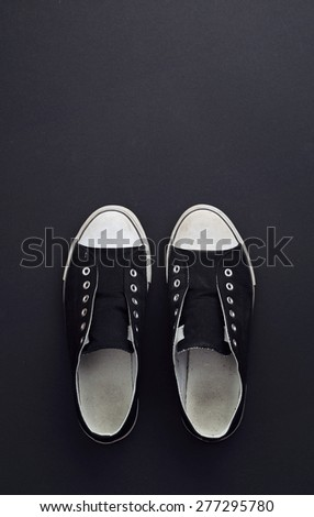 Black and White Sneakers over dark black background. This image is part of a large series.