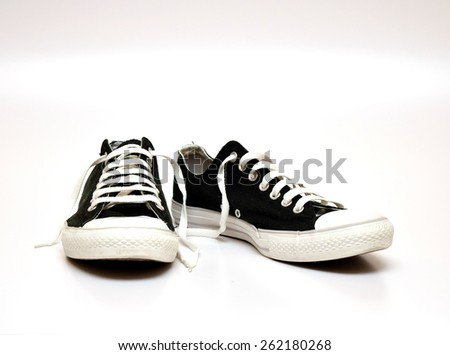 black and white sneakers shoes isolated on white background