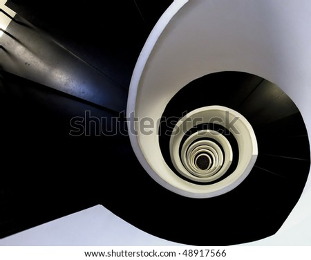 Black and white spiralling stairs in Silken Hotel Bilbao - stock photo