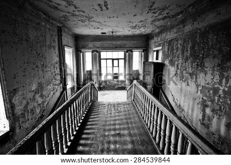 Black and white staircase in the abandoned estate