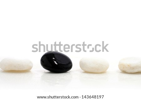 Black and white stones isolated over white.