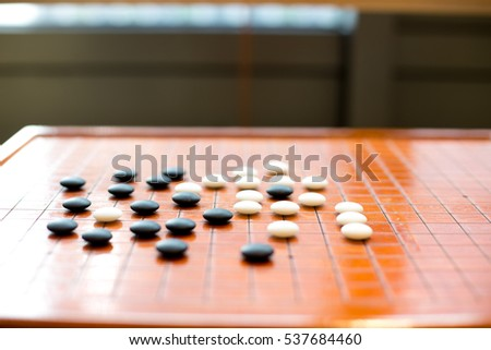 black and white stones on go board