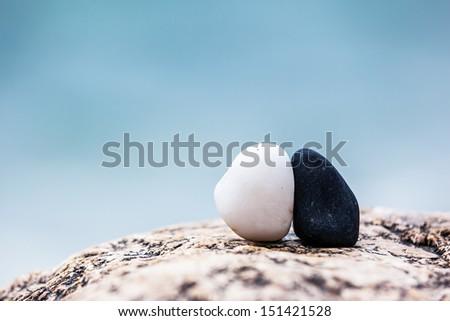 Black and white stones over blue sea. Crimea, Ukraine, Europe. Beauty world. - stock photo