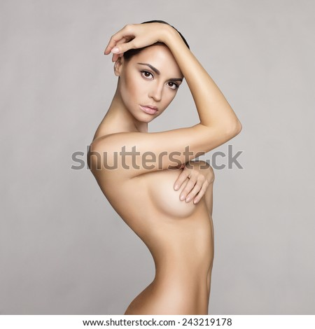 black and white studio photo of elegant naked lady - stock photo
